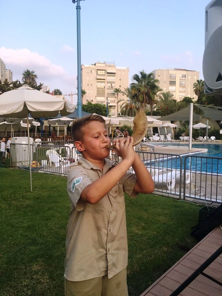 boy blowing a shofar