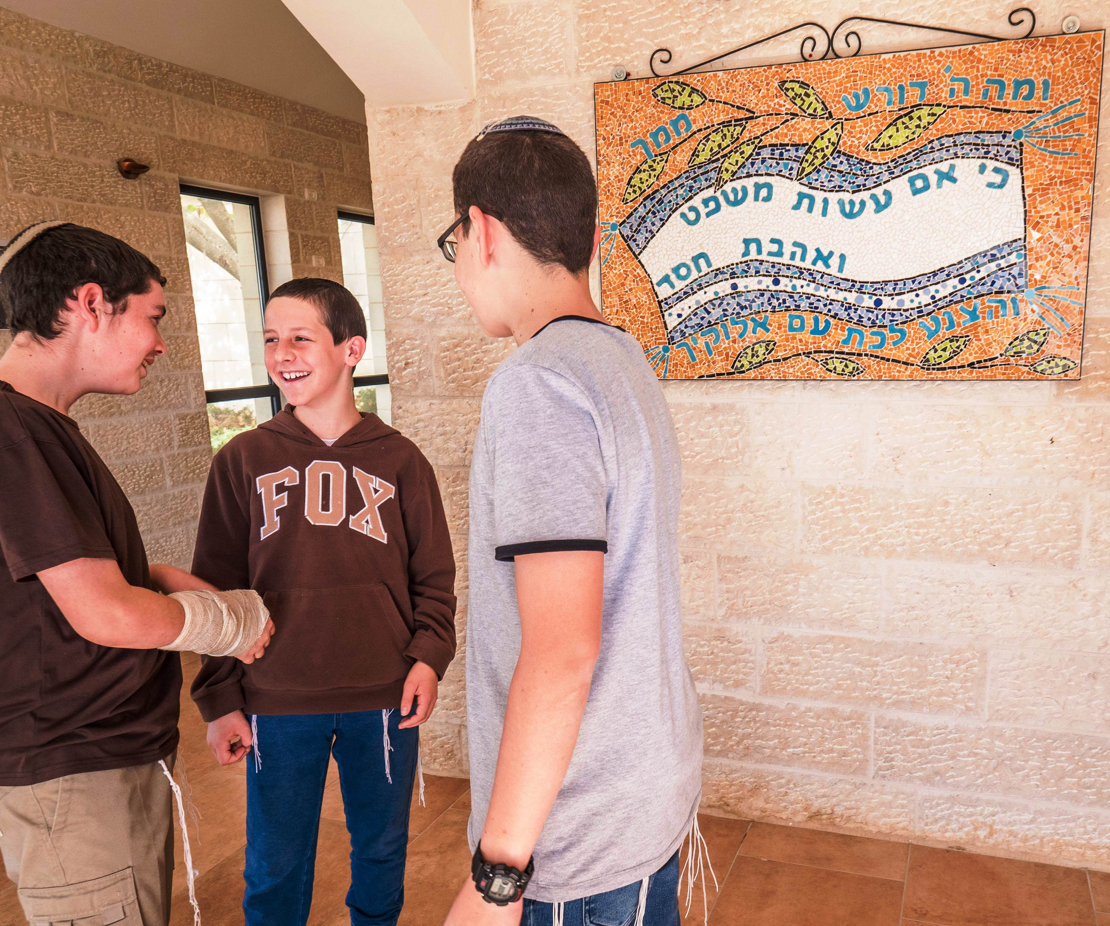 Students from Neveh Shmuel stand in the hallway