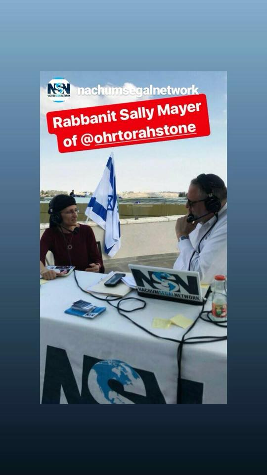 Sally Mayer being interviewed on the Inbal rooftop