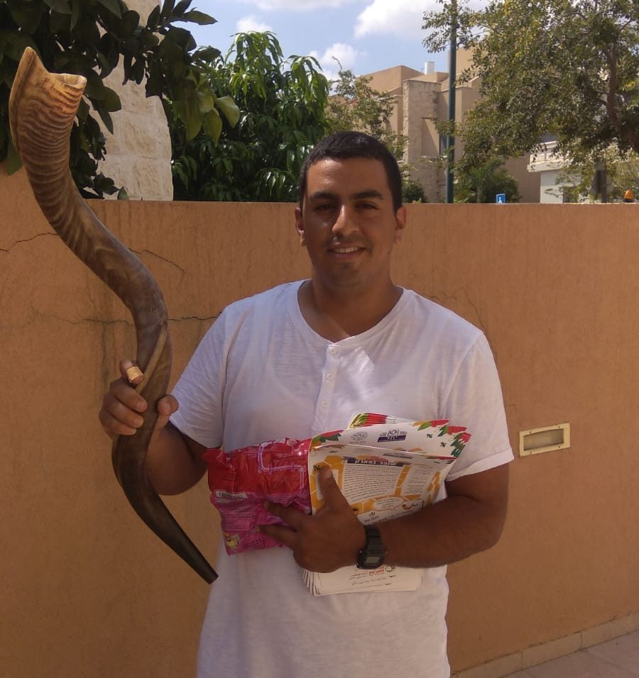 Photo of volunteer with a shofar