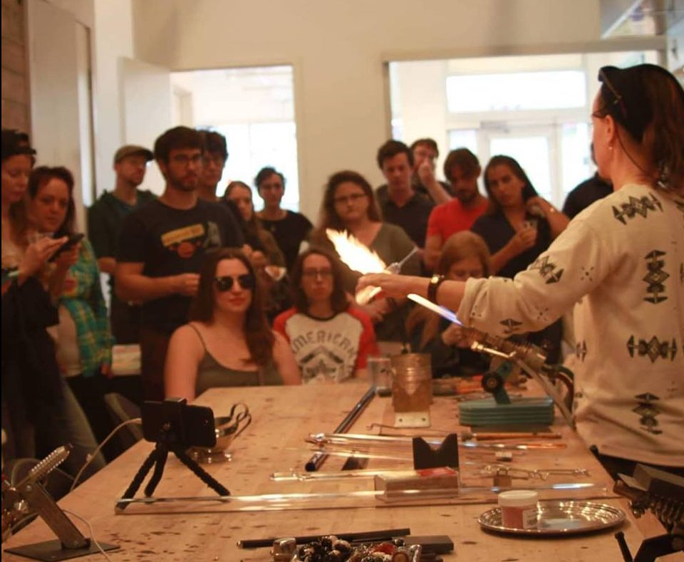 Sheva Chaya demonstrating glass blowing to New Orleans community