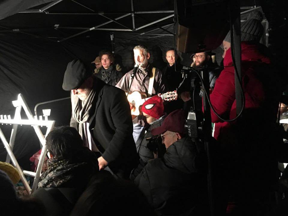 Rav Boaz Pash Lights Chanukah Candles in Warsaw
