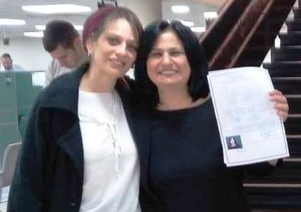 Dina and her advocate Limor with get in hand