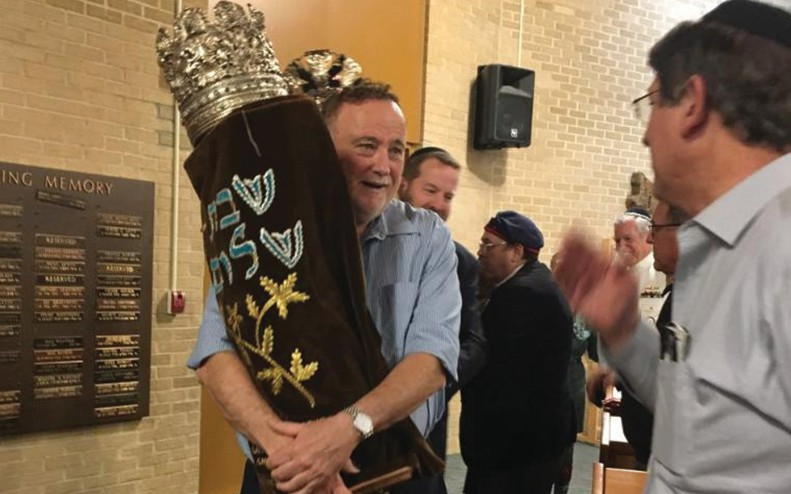 Bentzi Gruber carrying Torah