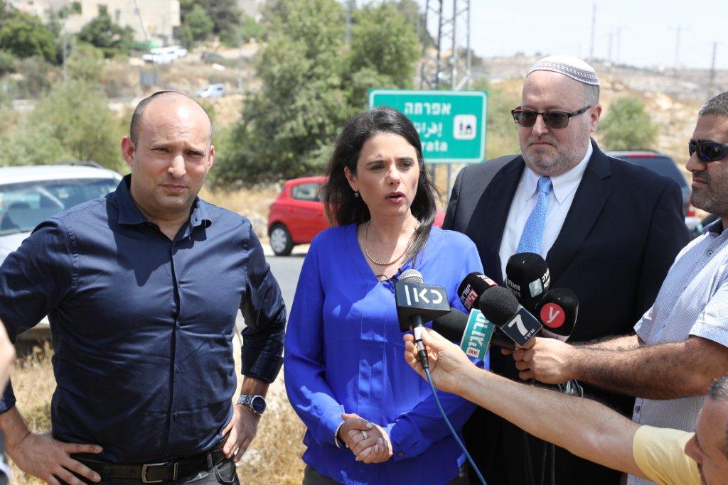 Left to Right: Naftali Bennett, Ayelet Shaked and Rabbi Kenneth Brander at the site of Dvir Sorek hyd's murder