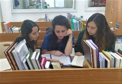 Roni Roth (right) studying with friends